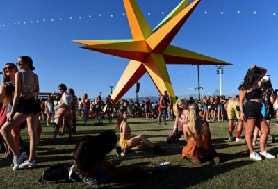 Festival goers pose in front of the SUPERNOVA art installation, by Roberto Behar & Rosario Marquardt (R&R Studios), during day 2 of the Coachella Valley Music and Arts Festival at the Empire Polo Club in Indio, CA., Saturday, April 14, 2018. (Staff photo by Jennifer Cappuccio Maher, The Press-Enterprise/SCNG)